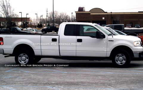 "Ford F-150 prototype - a super long wheelbase extended cab with six ""doors."